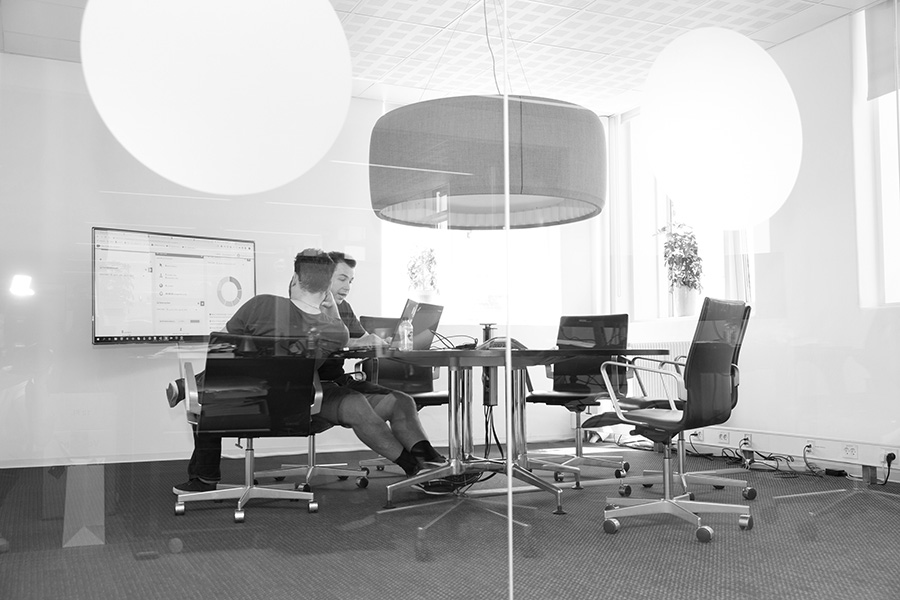 Meeting in room - Alpha Solutions