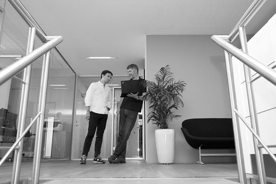 Talk in hallway - Alpha Solutions