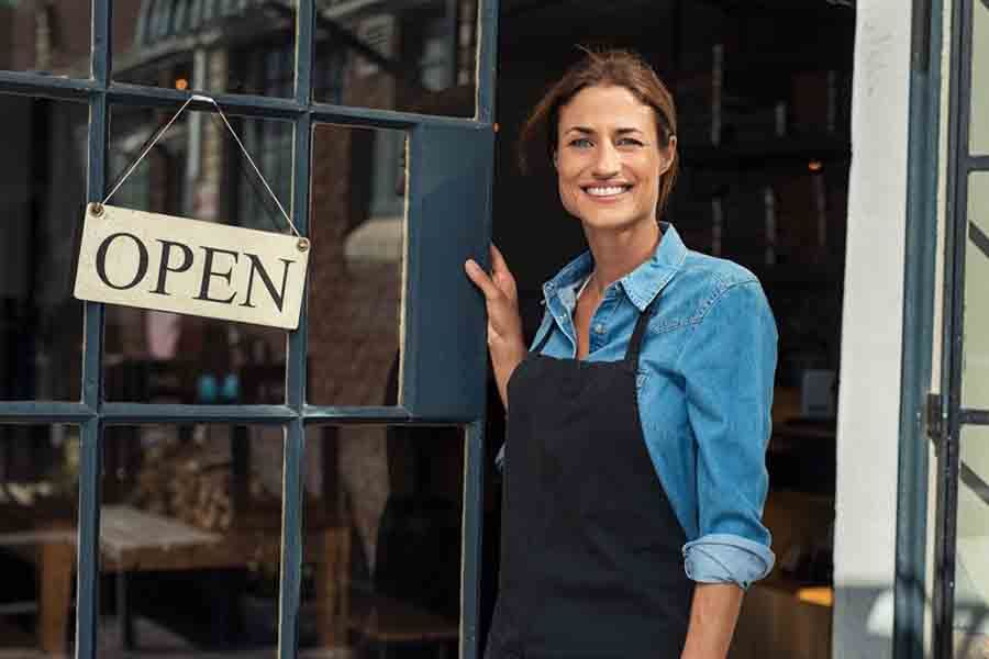 Woman at small business entrance - Alpha Solutions